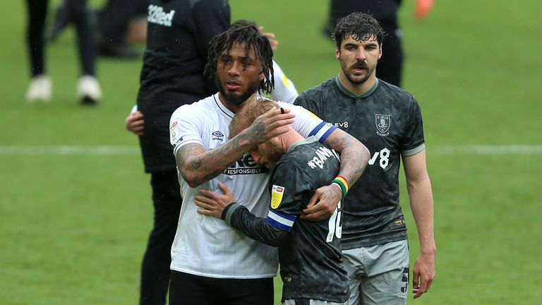 Derby striker Colin Kazim-Richards consoles Sheffield Wednesday's Barry Bannan after the sides' 3-3 draw confirmed the Owls' relegation