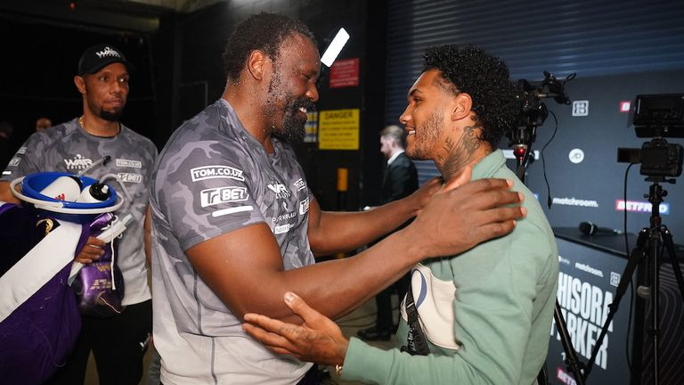 *** FREE FOR EDITORIAL USE ***.Derek Chisora vs Joseph Parker, Heavyweight Contest..2 May 2021.Picture By Dave Thompson Matchroom Boxing..Derek Chisora speaks with Conor Benn after losing the contest.