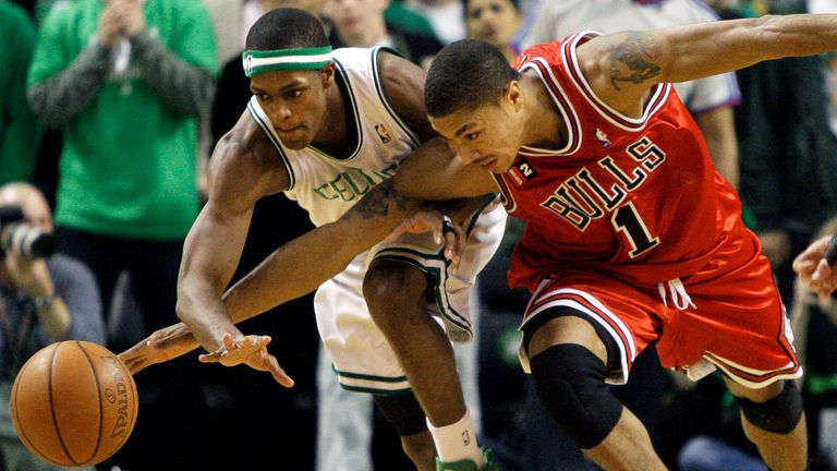 Chicago Bulls guard Derrick Rose and Boston Celtics guard Rajon Rondo fight for control of the ball during the fourth quarter of the opening game of an NBA playoff series in Boston Saturday, April 18, 2009.
