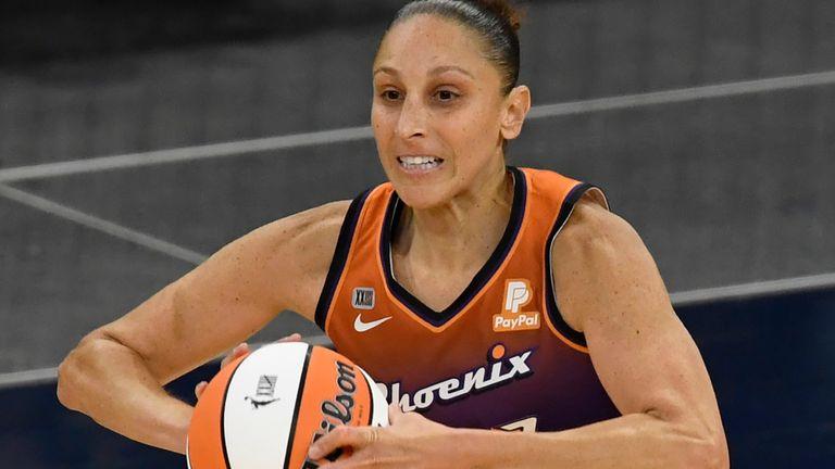 Phoenix Mercury guard Diana Taurasi (3) passes the ball during a WNBA basketball game, Friday, May 14, 2021, in Minneapolis. (AP Photo/Hannah Foslien)