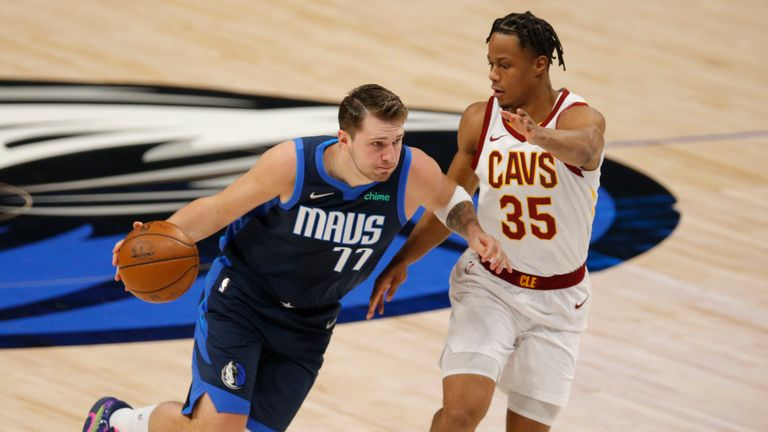 Dallas Mavericks guard Luka Doncic drives against Cleveland Cavaliers forward Isaac Okoro