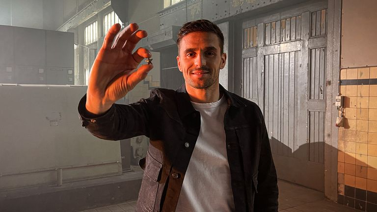 Ajax's Dusan Tadic hold sup the commemorative star which will be sent to all of the club's season-ticket holders