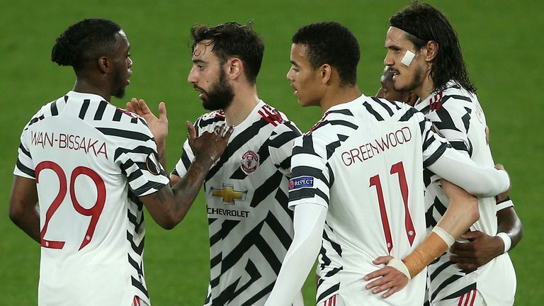 Manchester United's Edinson Cavani (right) celebrates scoring against Roma