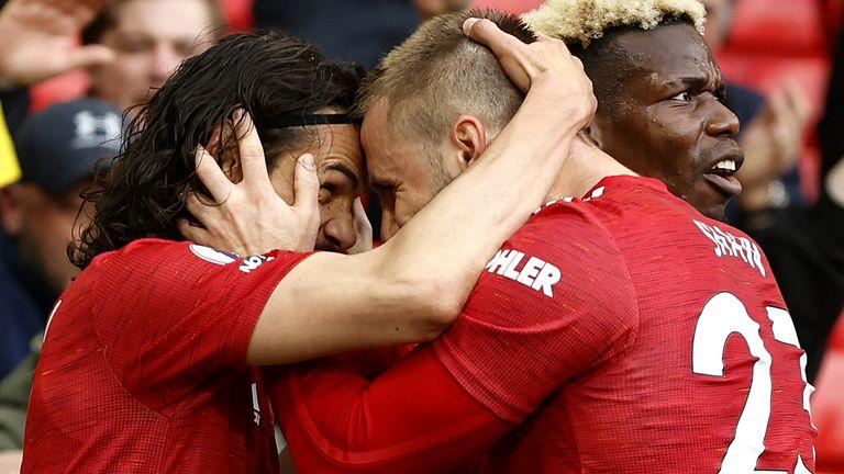Edinson Cavani celebrates his goal with Luke Shaw and Paul Pogba