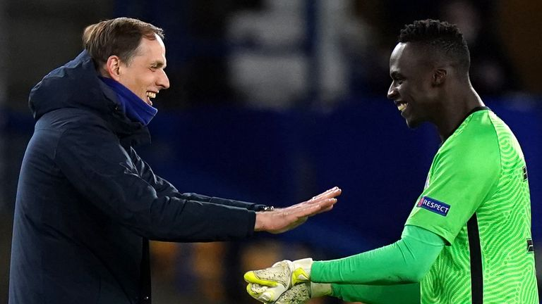 Thomas Tuchel celebrates with Edouard Mendy after the goalkeeper's record eighth clean sheet in the Champions League this season