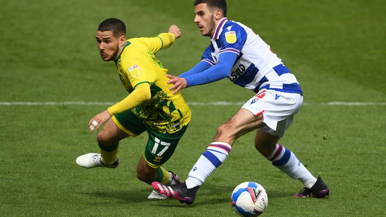 Emi Buendia and Reading's Dejan Tetek vie for the ball at Carrow Road