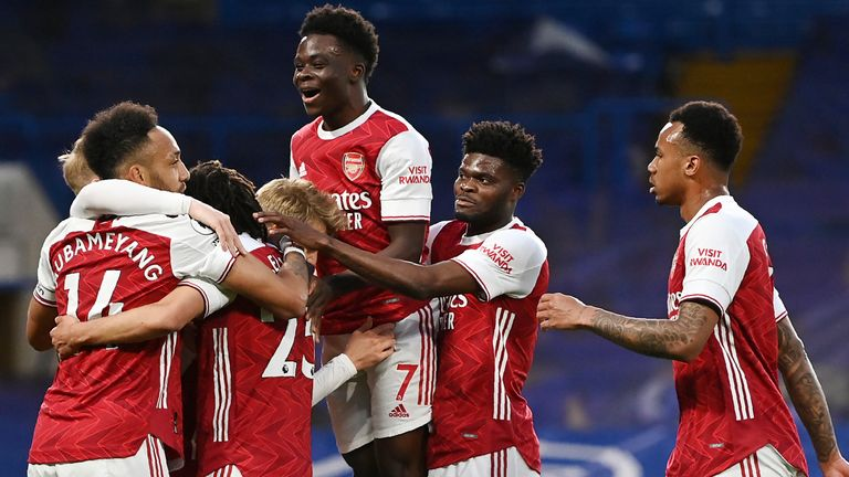 Arsenal's Emile Smith Rowe celebrates with his team-mates after scoring against Chelsea
