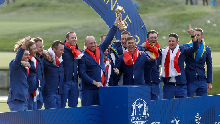 Europe team captain Thomas Bjorn holds up the trophy after the European won the 2018 Ryder Cup golf