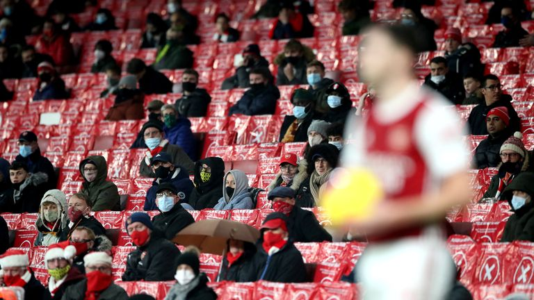 Arsenal fans watch on at the Emirates Stadium earlier in the season during a campaign in which most matches have been played behind closed doors
