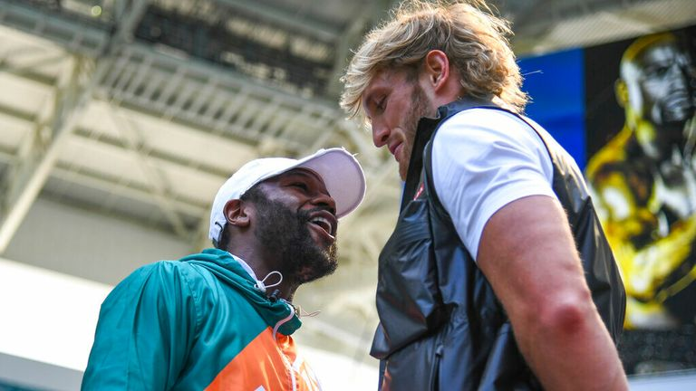 Boxer Floyd Mayweather Jr. (left) and media personality Logan Paul (right) during a media face-off event on Thursday, May 6, 2021 in Miami Gardens, Fla. (Carlos Goldman/Miami Dolphins via AP)