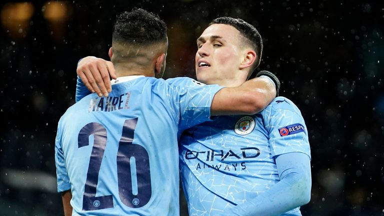 Phil Foden celebrates with Riyad Mahrez