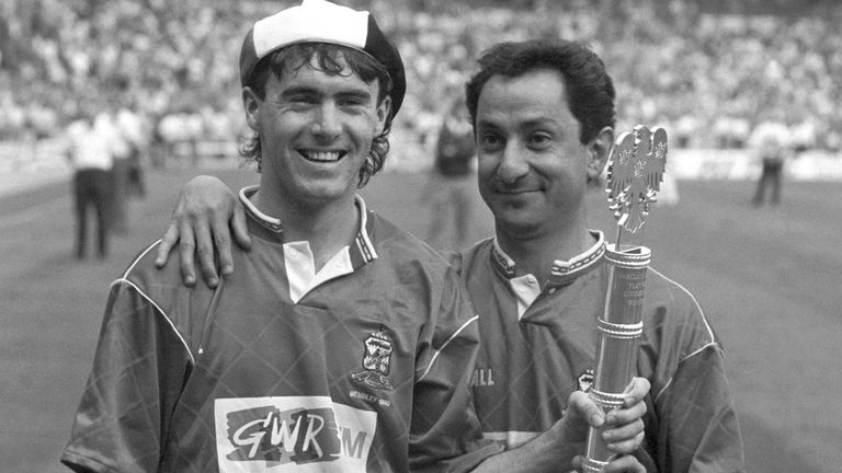 Alan McLoughlin and manager Ossie Ardiles celebrate with the Barclays League Division Two playoff final trophy in 1990