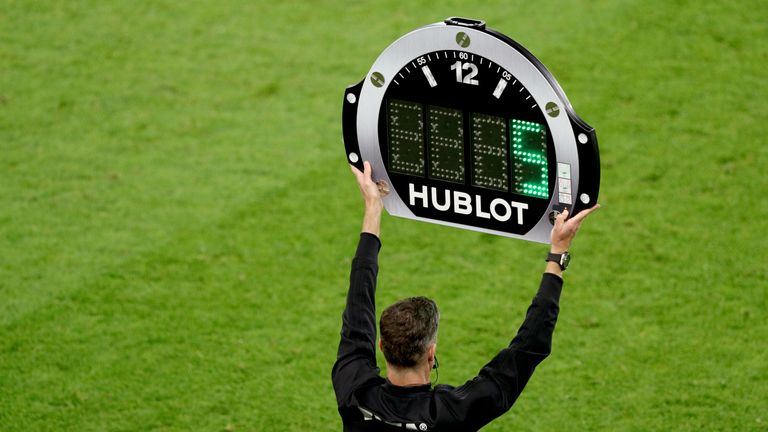PA - Fourth official holds board displaying five added on minutes