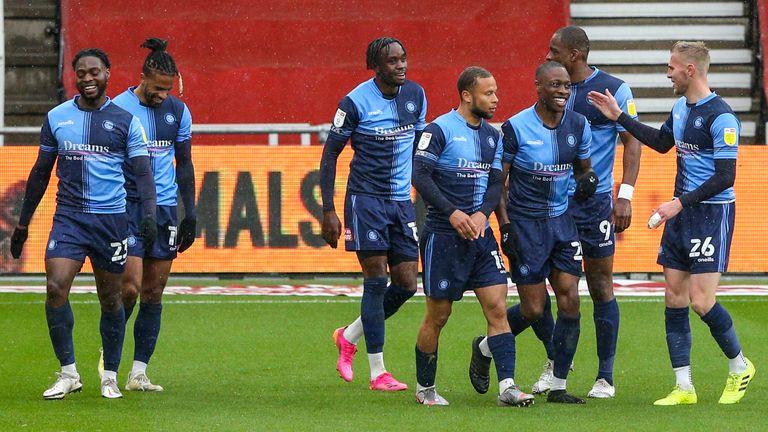 Wycombe Wanderers players celebrate Fred Onyedinma's opening goal