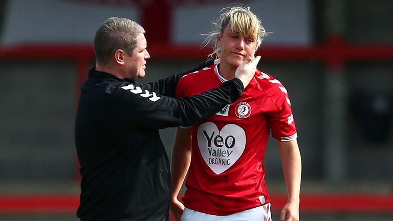 Bristol City's Gemma Evans is consoled by manager Matt Beard