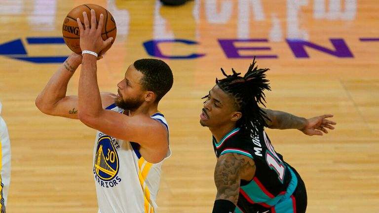 Golden State Warriors guard Stephen Curry (30) shoots a 3-point basket in front of Memphis Grizzlies guard Ja Morant during the second half of an NBA basketball game in San Francisco, Sunday, May 16, 2021. (AP Photo/Jeff Chiu)
