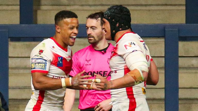 Grace celebrates one of his three superb tries on Friday