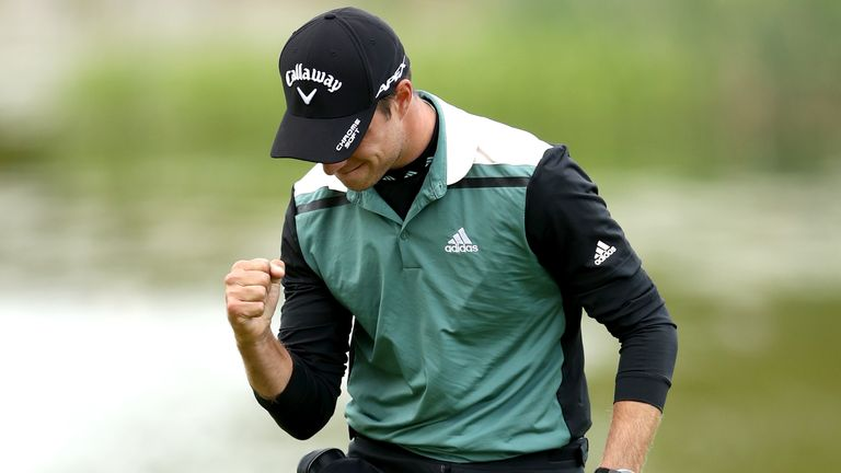Guido Migliozzi reacts after making a par at the 18th to secure his place in the play-off