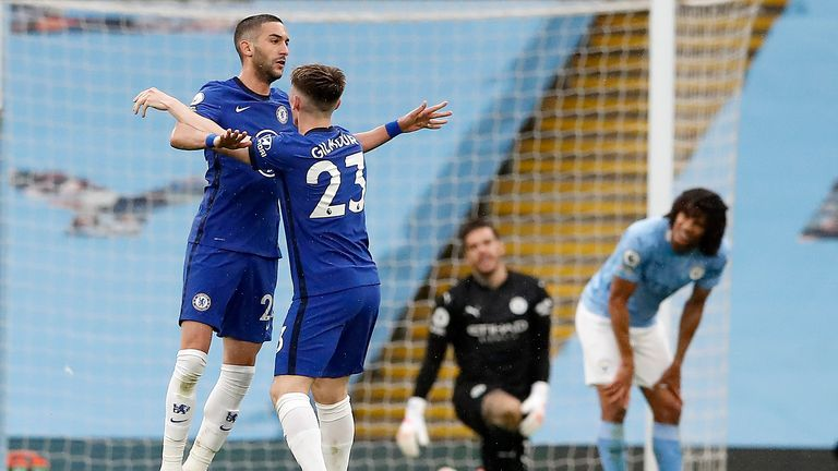 Hakim Ziyech celebrates the equaliser with Billy Gilmour (AP)