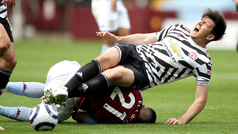 Harry Maguire is injured in a collision with Anwar El Ghazi