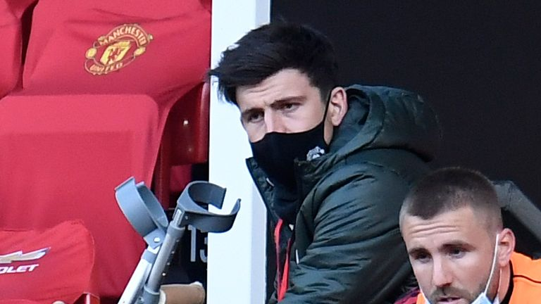 Harry Maguire watches on from the stands during Man Utd's 4-2 defeat to Liverpool