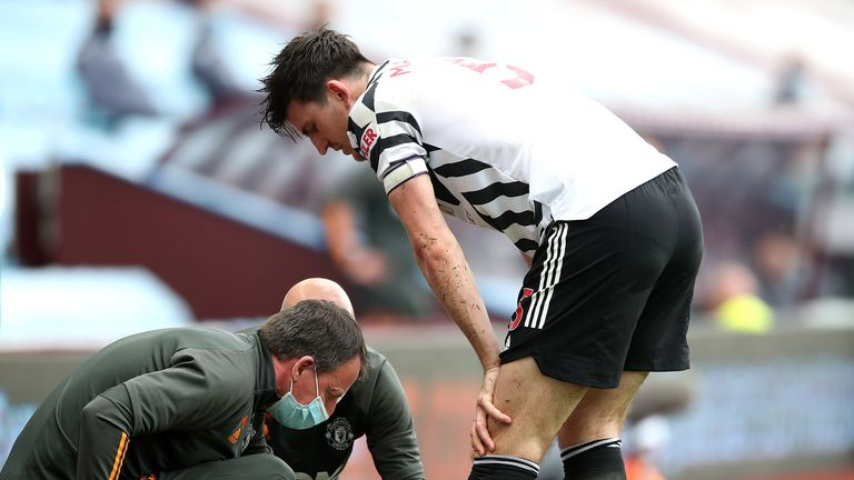 Manchester United's Harry Maguire receives medical attention during the Premier League match at Villa Park, Birmingham. Picture date: Sunday May 9, 2021.