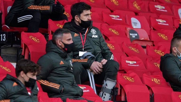 Harry Maguire had crutches and wore a brace when watching on from the stands during Man Utd's 4-2 defeat to Liverpool on Thursday