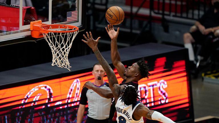 Miami Heat forward Jimmy Butler goes up for a shot against Minnesota Timberwolves forward Jarred Vanderbilt