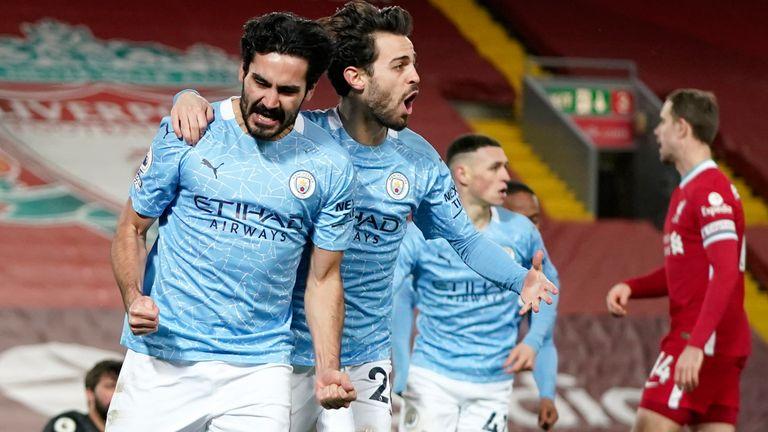 Manchester City's Ilkay Gundogan, left, celebrates with Bernardo Silva - For Shorthand Feature