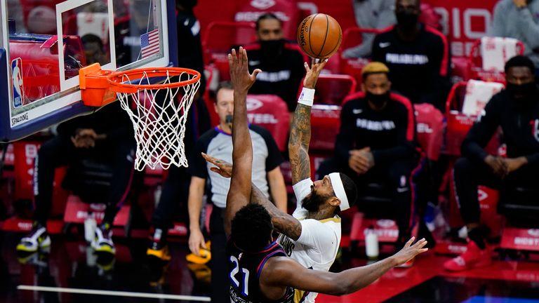 New Orleans Pelicans' James Johnson goes up for a shot against Philadelphia 76ers' Joel Embiid