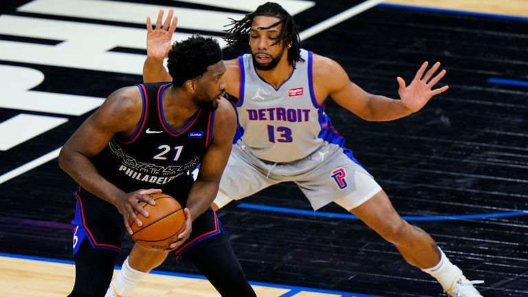 Philadelphia 76ers' Joel Embiid ,left, tries to get around Detroit Pistons' Jahlil Okafor during the first half of an NBA basketball game, Saturday, May 8, 2021, in Philadelphia.
