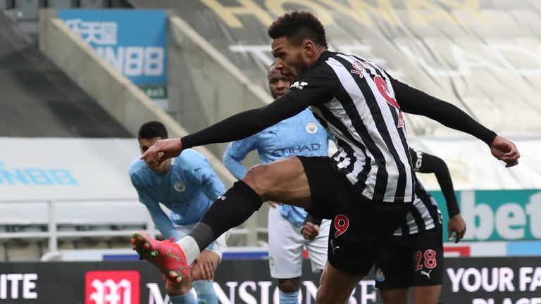 Newcastle's Joelinton, right, scores his side's second goal during the English Premier League soccer match between Newcastle United and Manchester City at St James' Park stadium, in Newcastle, England, Friday, May 14, 2021. (AP Photo/Scott Heppell, Pool)