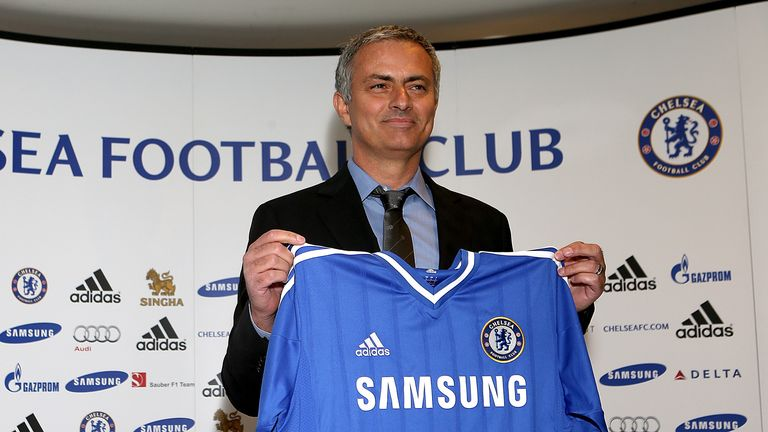 Chelsea's new manager Jose Mourinho holds up the club shirt during a press conference at Stamford Bridge.