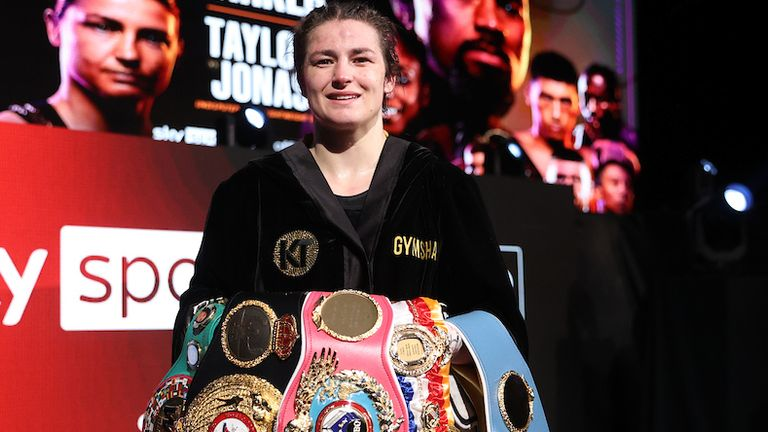 *** FREE FOR EDITORIAL USE ***.Katie Taylor vs Natasha Jonas, WBC, WBA, IBF and WBO Female Lightweight Title Fight..1 May 2021.Picture By Mark Robinson Matchroom Boxing..Katie Taylor celebrates with Eddie Hearn and her team after her victory.