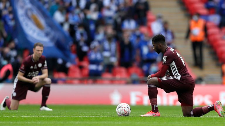 Kelechi Iheanacho of Leicester City takes a knee in support of the 'Black Lives Matter' movement prior to The Emirates FA Cup Final match between Chelsea and Leicester City at Wembley Stadium on May 15, 2021 in London, England.