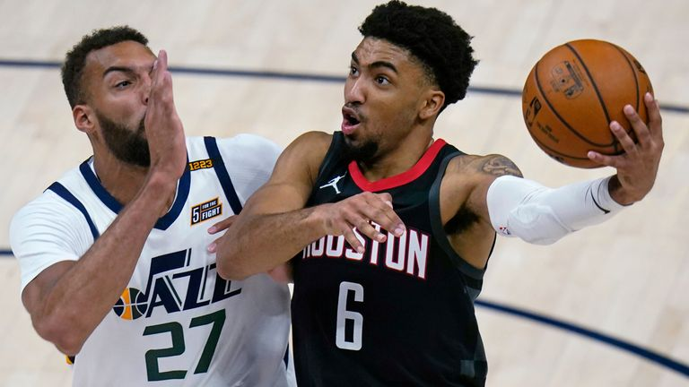 Houston Rockets forward Kenyon Martin Jr. (6) goes to the basket as Utah Jazz center Rudy Gobert (27) defends in the second half during an NBA basketball game Saturday, May 8, 2021, in Salt Lake City. (AP Photo/Rick Bowmer)
