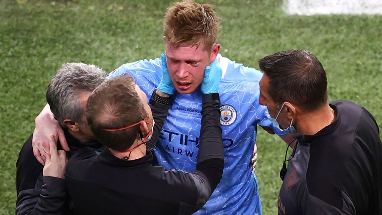 Manchester City's Kevin De Bruyne is assisted after a foul by Chelsea's Antonio Rudiger during the Champions League final soccer match between Manchester City and Chelsea at the Dragao Stadium in Porto, Portugal, Saturday, May 29, 2021.