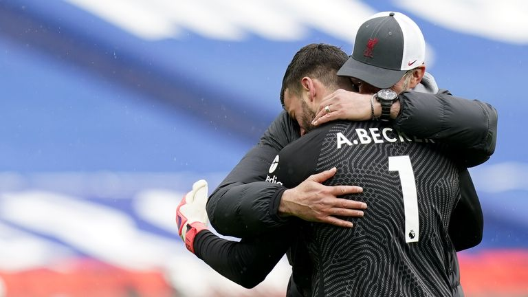 Jurgen Klopp embraces Alisson after his last-gasp winner for Liverpool at West Brom