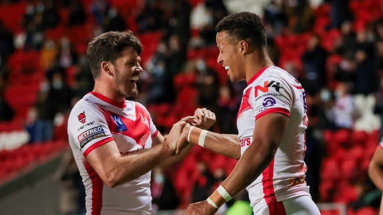Picture by Alex Whitehead/SWpix.com - 17/05/2021 - Rugby League - Betfred Super League - St Helens v Salford Red Devils - Totally Wicked Stadium, St Helens, England - St Helens' Regan Grace celebrates with Lachlan Coote after scoring a try.