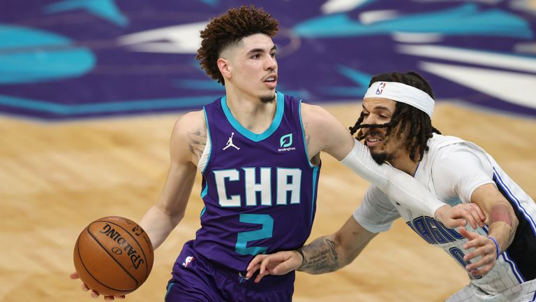 Charlotte Hornets guard LaMelo Ball drives against Orlando Magic guard Cole Anthony