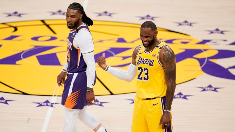 Los Angeles Lakers forward LeBron James talks with Phoenix Suns' Jae Crowder during the second half in Game 3 of an NBA basketball first-round playoff series