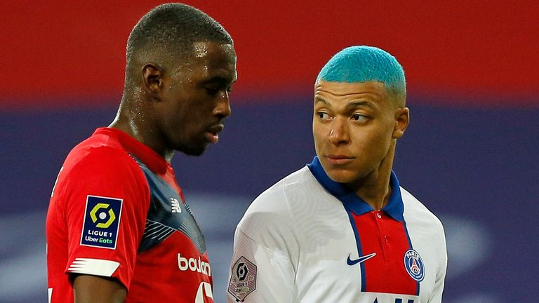 Boubakary Soumare marking Kylian Mbappe in a match back in December - Lille pipped PSG to the Ligue 1 title by one point