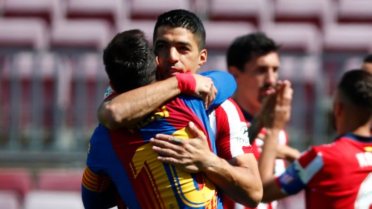 Luis Suarez and Lionel Messi embrace ahead of kick-off