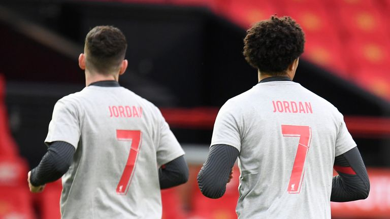 Liverpool players wearing t-shirts paying tribute to 9-year-old fan Jordan Banks during warm up before the English Premier League soccer match between Manchester United and Liverpool, at the Old Trafford stadium in Manchester, England, Thursday, May 13, 2021. (Peter Powell/Pool via AP)