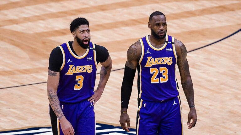 Los Angeles Lakers forward LeBron James (23) and forward Anthony Davis (3) during a time out in the second quarter of an NBA basketball game against the New Orleans Pelicans in New Orleans, Sunday, May 16, 2021. (AP Photo/Derick Hingle)