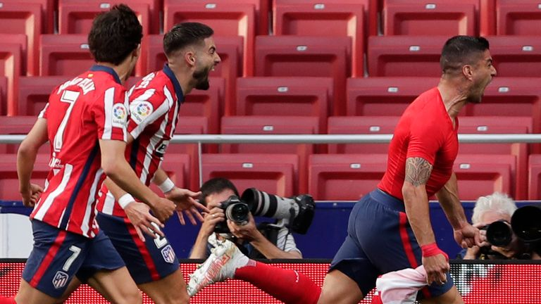 Luis Suarez scored a late winner for Atletico Madrid to put them on the brink of the La Liga title