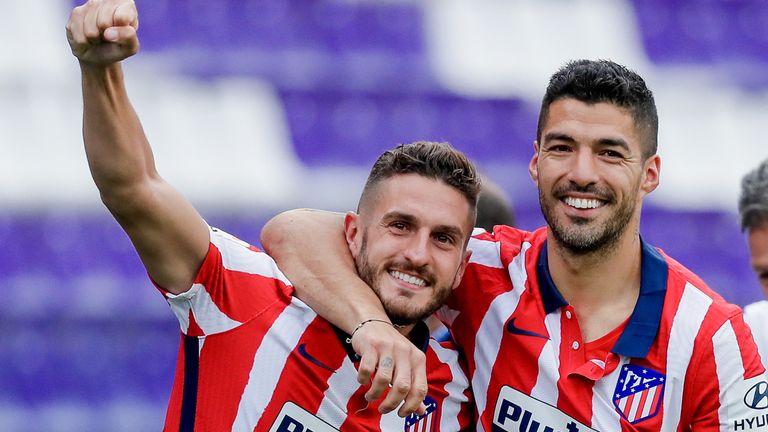 Koke and Luis Suarez celebrate Atletico Madrid's La Liga triumph