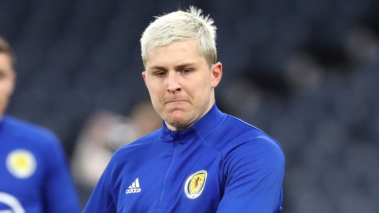 Injury fears concerning Scotland's Lyndon Dykes have been played down by QPR boss Mark Warburton