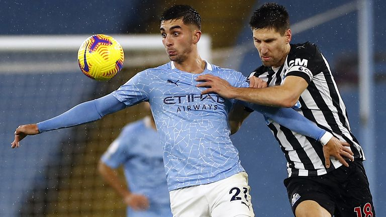 Manchester City's Ferran Torres and Newcastle United's Federico Fernandez battle for the ball