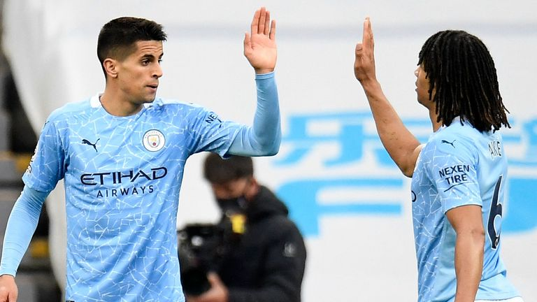 Joao Cancelo high-fives Nathan Ake after equalising for Man City
